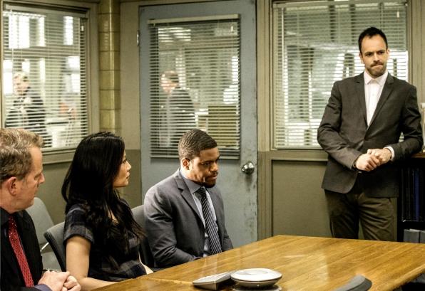 Gregson, Joan, Bell, and Sherlock at the precinct