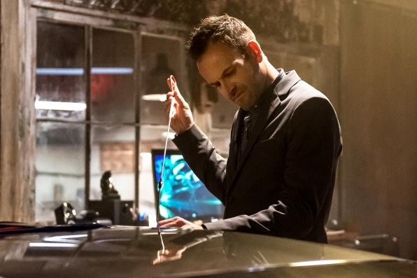 Sherlock (Jonny Lee Miller) in Alfonso's workshop