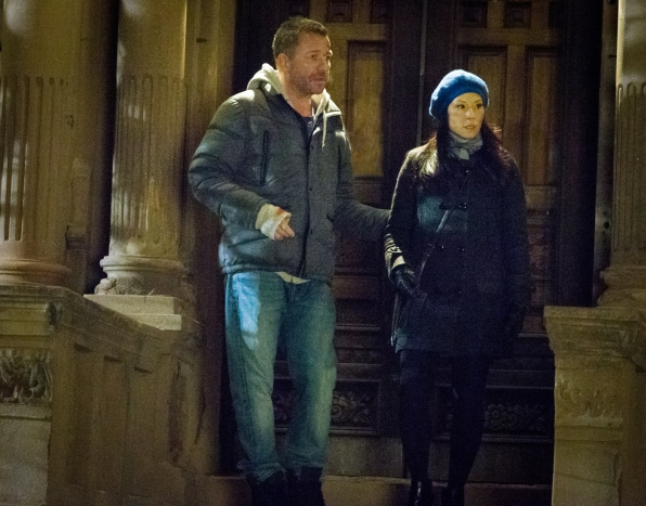 Joan and Lestrade outside the Brownstone.