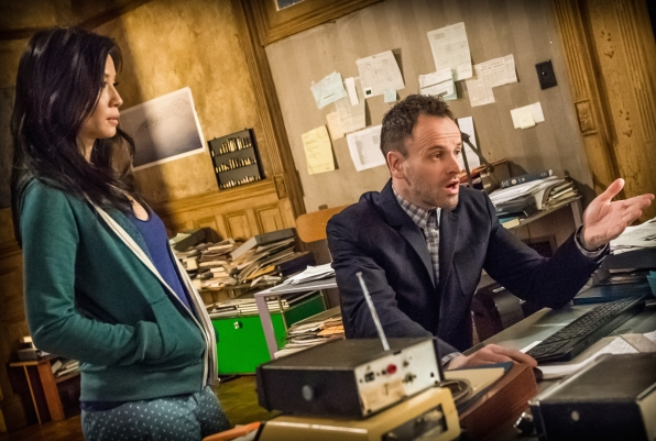 Joan and Sherlock review evidence in their latest case.