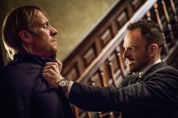 Sherlock attacking Mycroft in a rage after learning Joan has been abducted.