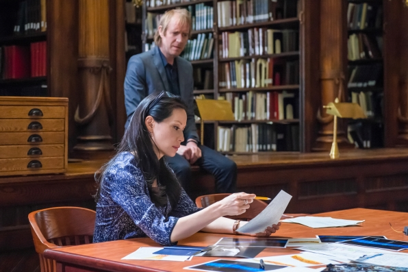 Joan and Mycroft trying to figure out who framed him.