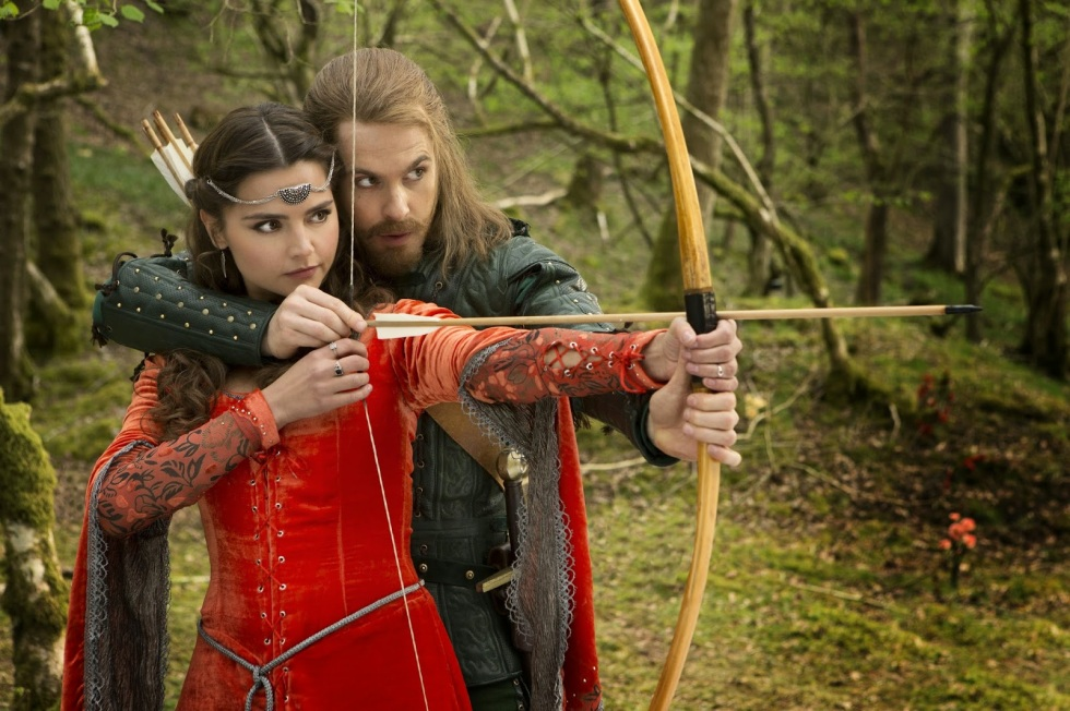 Robin teaches Clara a bit of archery.