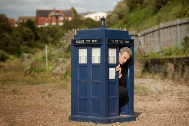 The Doctor, peeking out of the shrunk TARDIS